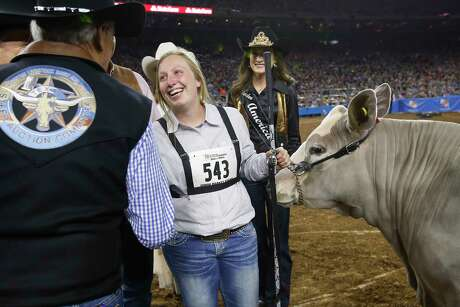 Lillyan Digby, of Hermleigh, Texas, is congratulated, after she and her steer, Hank, won Grand Champion Steer of Show during the Houston Livestock Show and Rodeo at NRG Stadium on Friday, March 15, 2019, in Houston.