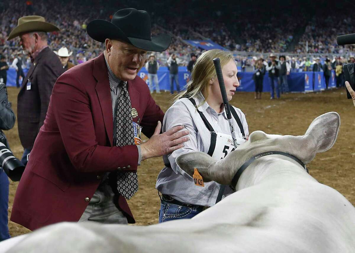 Lillyan Digby, of Hermleigh, Texas, and her steer, Hank, are named Grand Champion Steer of Show during the Houston Livestock Show and Rodeo at NRG Stadium on Friday, March 15, 2019, in Houston.
