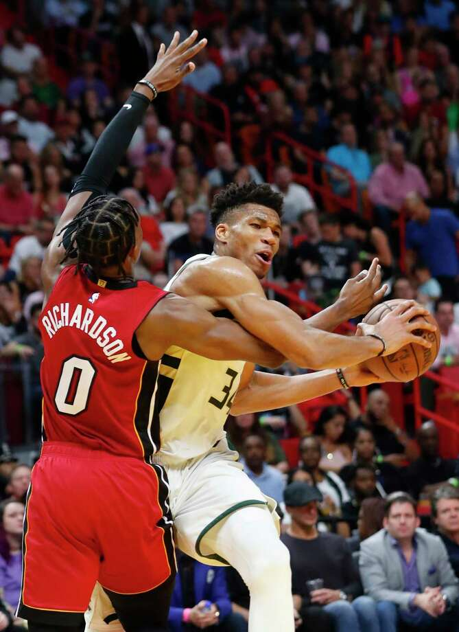 Milwaukee Bucks forward Giannis Antetokounmpo, right, drives to the basket against Miami Heat guard Josh Richardson during the second half of an NBA basketball game Friday, March 15, 2019, in Miami. The Bucks defeated the Heat 113-98. (AP Photo/Wilfredo Lee) Photo: Wilfredo Lee / Copyright 2019 The Associated Press. All rights reserved