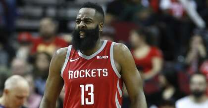 78c65b02e39 Houston Rockets guard James Harden (13) reacts after getting up slowly  after crashing into Phoenix Suns center Deandre Ayton (22) during the  second half of ...