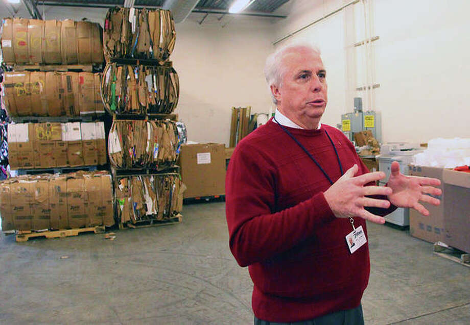 With bales of recyclable materials in the background, Pathway Services Unlimited Executive Director Steve Brundage describes how the operation will go forward in a reduced capacity. Photo: Rosalind Essig | Journal-Courier