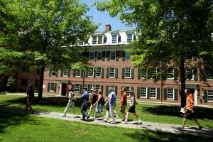 In this file photo, visitors walk in front of Edwin McClellan Hall on Yale University's Old Campus during a Yale University Visitor Center walking tour of the Yale Campus.