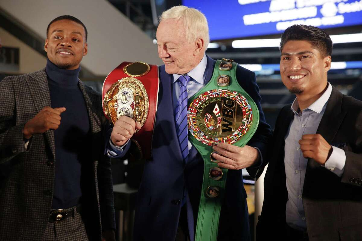 Boxers Errol Spence Jr., left, and Mikey Garcia, right, are pictured with Cowboys owner Jerry Jones at a promotional event in February. They will fight Saturday for the IBF Welterweight World Championship belt at AT&T Stadium.