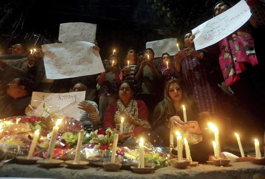 Members of civil society group 'Joint Action Committee for People Rights' hold a candle light vigil for the victims of Christchurch mosque shooting, in Lahore, Pakistan, Saturday, March 16, 2019. Pakistan's foreign minister says at least six Pakistanis were killed in the New Zealand mosque shootings. Shah Mahmood Qureshi says authorities in Christchurch, where the shootings took place, are trying to determine whether three other Pakistanis who have been missing since Friday's attack were among the fatalities. Photo: K.M. Chaudary / Associated Press / Copyright 2019 The Associated Press. All rights reserved.
