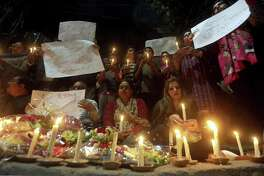 Members of civil society group 'Joint Action Committee for People Rights' hold a candle light vigil for the victims of Christchurch mosque shooting, in Lahore, Pakistan, Saturday, March 16, 2019. Pakistan's foreign minister says at least six Pakistanis were killed in the New Zealand mosque shootings. Shah Mahmood Qureshi says authorities in Christchurch, where the shootings took place, are trying to determine whether three other Pakistanis who have been missing since Friday's attack were among the fatalities.