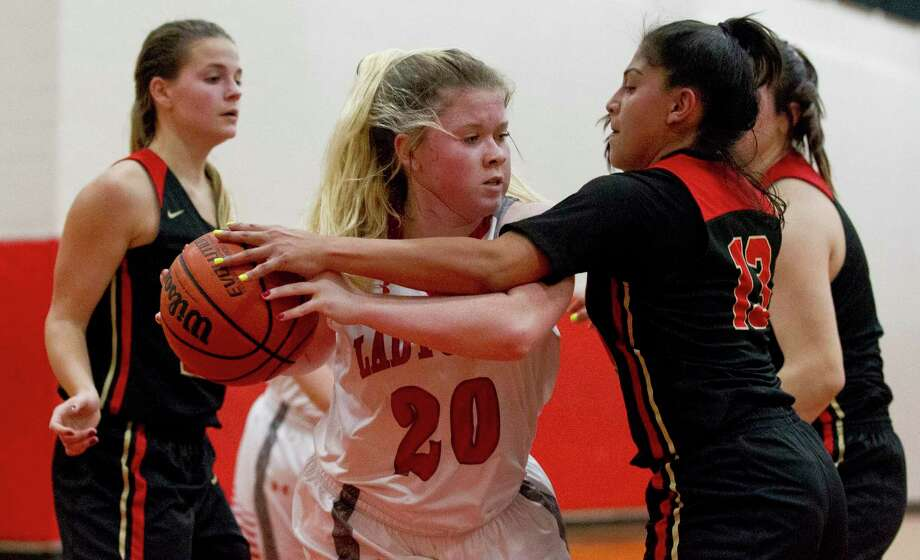 Splendora guard Erin Kendall (20) looks to pass after a rebound as Caney Creek guard Daniella Faz (13) pressures in the fourth quarter of a game duing the Splendora baketball tournament, Thursday, Nov. 15, 2018, in Splendora. Photo: Jason Fochtman, Houston Chronicle / Staff Photographer / © 2018 Houston Chronicle