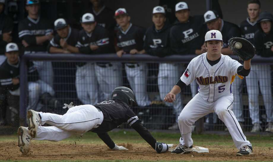 Midland High's Austin Price gets the ball too late on a pick-off attempt at first as Permian's Aleck Villa safely makes it back 03/16/2019 at Zachery Field. Tim Fischer/Reporter-Telegram Photo: Tim Fischer