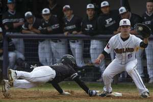 Midland High's Austin Price gets the ball too late on a pick-off attempt at first as Permian's Aleck Villa safely makes it back 03/16/2019 at Zachery Field. Tim Fischer/Reporter-Telegram