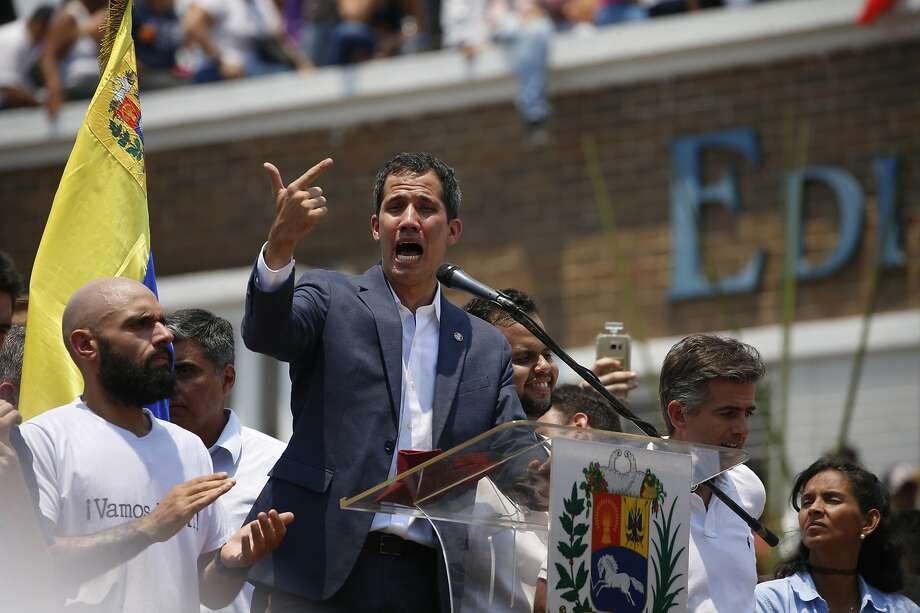 Opposition leader Juan Guaidó addresses his backers at a rally in the northern city of Valencia. Photo: Fernando Llano / Associated Press