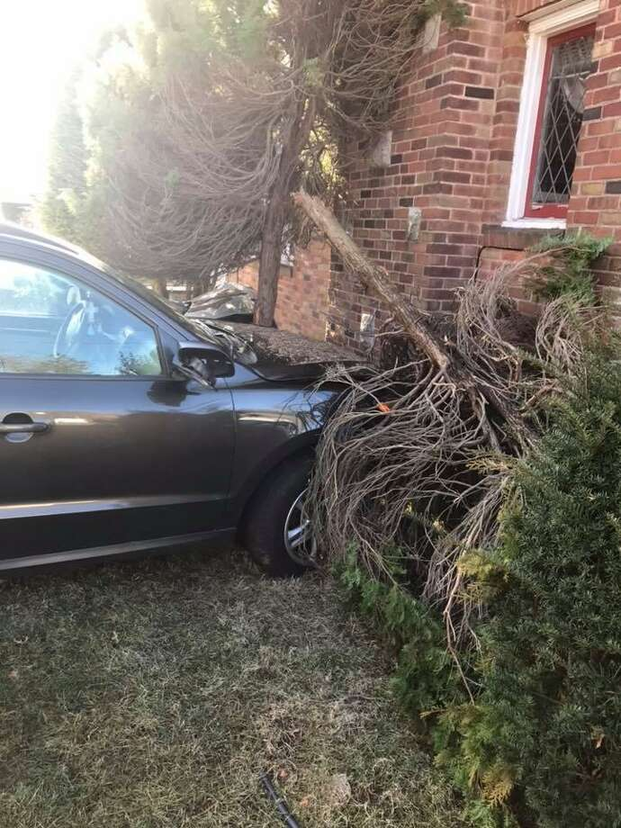 Two people were hospitalized after a two-car collision that included both vehicles striking a home, according to the Hamden Fire Department. Photo: Hamden Fire Department