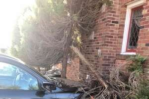 Two people were hospitalized after a two-car collision that included both vehicles striking a home, according to the Hamden Fire Department.