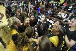 Trinity Catholic celebrates their 52-45 win over Canton in the CIAC 2019 State Girls Basketball Tournament Class S Finals at the Mohegan Sun Arena in Uncasville, Conn. on Saturday, March 16, 2019.