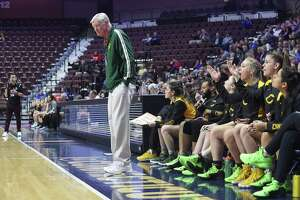 Trinity Catholic coach Mike Walsh reacts to a call on the court in the first half against Canton in the CIAC 2019 State Girls Basketball Tournament Class S Finals at the Mohegan Sun Arena in Uncasville on Saturday. Trinity Catholic defeated Canton 52-45.