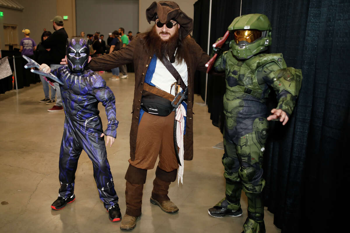 Odessans from left, Isaac Jones, dressed as Black Panther, Hector Granado, dressed as Capt. Jack Sparrow, and Azrael Jones, dressed as Master Chief, pose for a photo at the Permian Basin Comic Con X March 16, 2019 at Horseshoe Pavilion. James Durbin / Reporter-Telegram