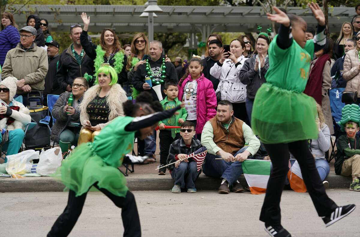 People watch during the 60th Annual St. Patrick's Day Parade downtown Saturday, March 16, 2019, in Houston.