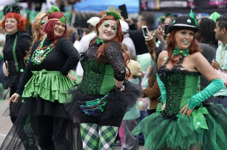 Members of the Tutu Live Krewe of Galveston perform during the 60th Annual St. Patrick's Day Parade downtown Saturday, March 16, 2019, in Houston. Photo: Melissa Phillip/Staff Photographer