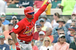 The Cardinals' Kolten Wong celebrates a home run off Detroit Tigers pitcher Michael Fulmer in a spring training gamae last week in St. Petersburg, Fla.