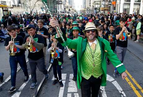 Student musicians from St. Barr Finn Catholic School march and perform in the annual St. Patrick's Day Parade on Market Street in San Francisco, Calif. on Saturday, March 16, 2019.