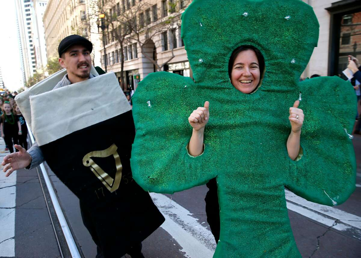 Revelers disguised as a pint of Guinness and a shamrock march in the annual St. Patrick's Day Parade on Market Street in San Francisco, Calif. on Saturday, March 16, 2019.