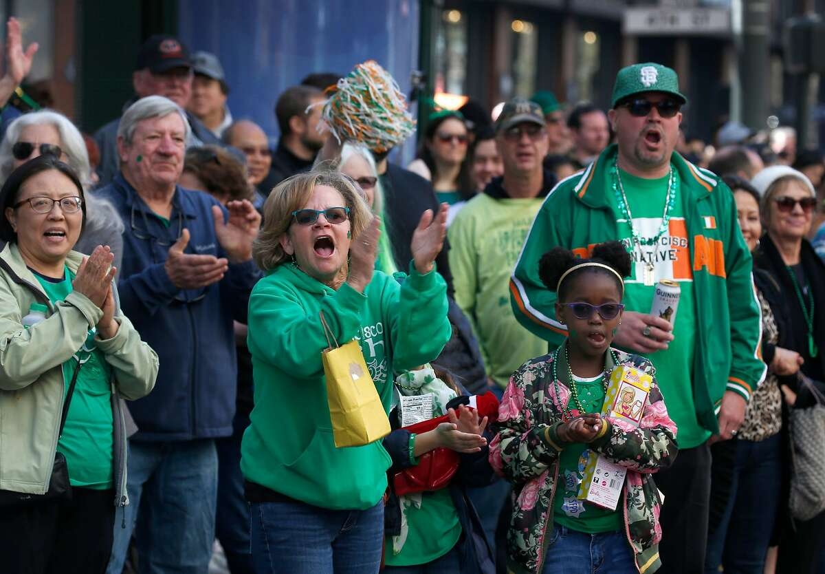 The crowd cheers as participants perform in the annual St. Patrick's Day Parade on Market Street in San Francisco, Calif. on Saturday, March 16, 2019.