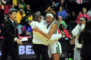 Norwalk's Sanaa Boyd hugs a friend after the team beat New London during Saturday's Class LL championship game.