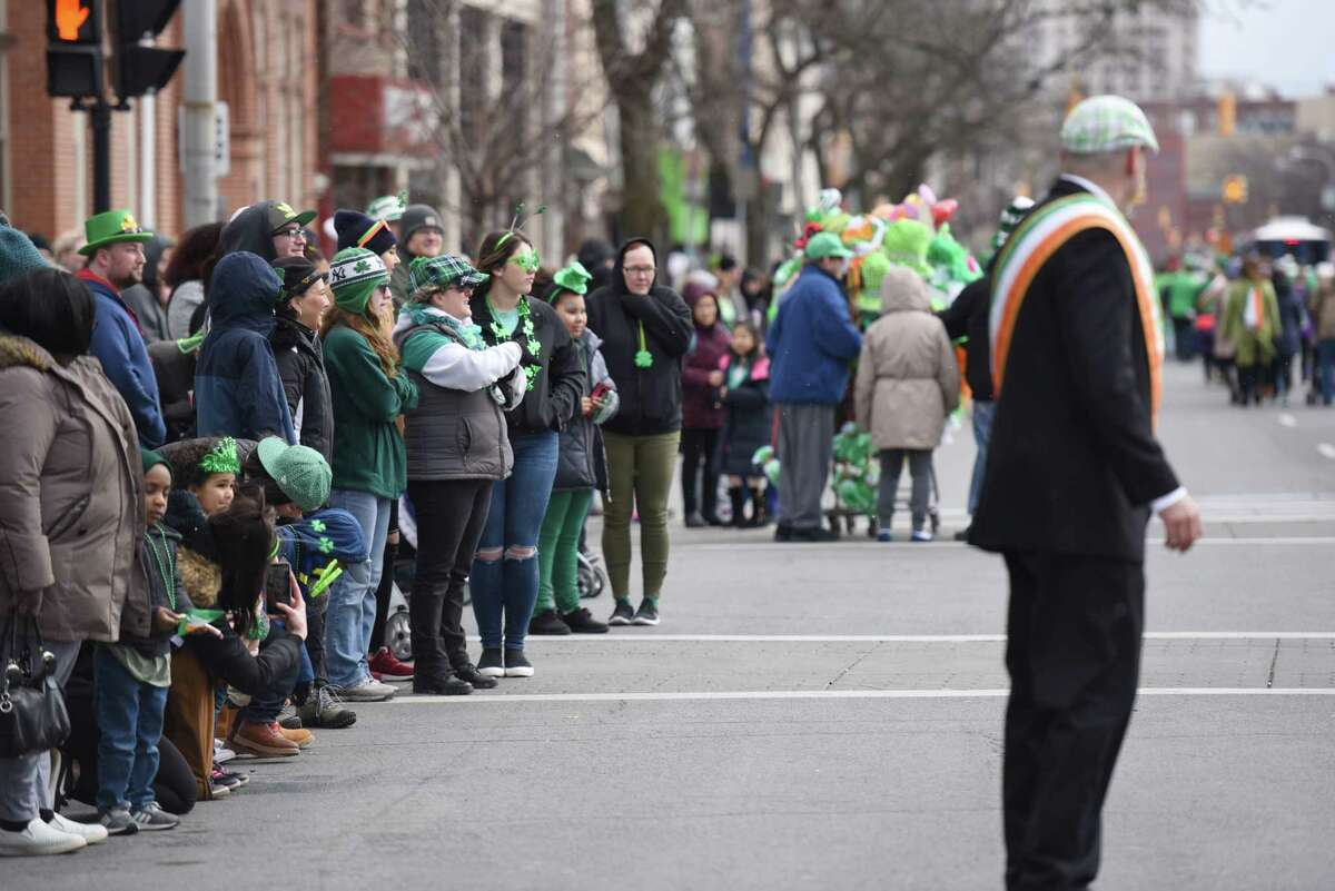 Parade goers watch from the sidewalk during the 69th Annual Albany St. Patrick's Day Parade on Saturday, March 16, 2019 in Albany, NY. (Phoebe Sheehan/Times Union)