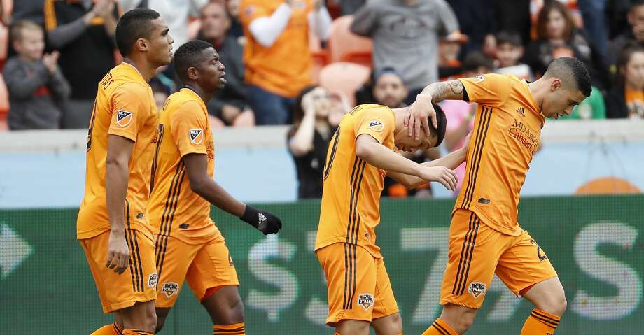 The Houston Dynamo celebrate a goal against the Vancouver Whitecaps during the first half of a Major League Soccer match at BBVA Compass Stadium on Saturday, March 16, 2019, in Houston. Photo: Brett Coomer/Staff Photographer