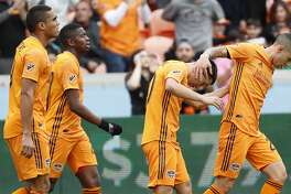 The Houston Dynamo celebrate a goal against the Vancouver Whitecaps during the first half of a Major League Soccer match at BBVA Compass Stadium on Saturday, March 16, 2019, in Houston.