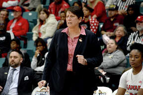 Lamar's head coach Robin Harmony reacts on the side as the Lady Cardinals begin to struggle late in the fourth quarter against Abilene Christian in the Southland tournament semi-final at the Merrell Center in Katy. Photo taken Saturday, March 16, 2019 Kim Brent/The Enterprise