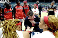 Lamar's coach Robin Harmony offers feedback as tehy get ready to head into the fourth quarter against Abilene Christian in the Southland tournament semi-final at the Merrell Center in Katy. Photo taken Saturday, March 16, 2019 Kim Brent/The Enterprise