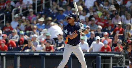 Houston Astros designated hitter Michael Brantley bats during the first inning of an exhibition spring training baseball game against the Washington Nationals Sunday, March 3, 2019, in West Palm Beach, Fla. (AP Photo/Jeff Roberson)