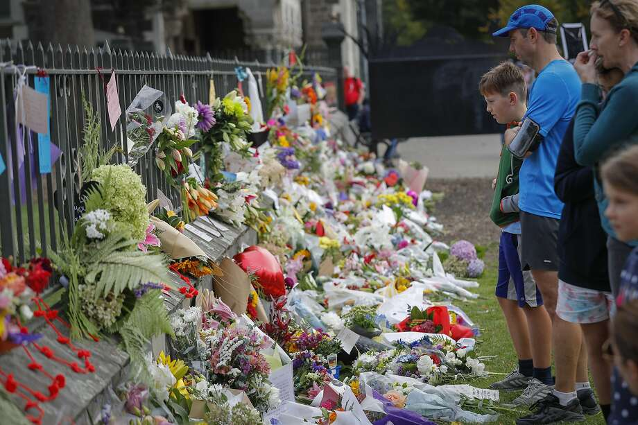 Mourners leave flowers at the Botanical Gardens in Christchurch in tribute to the victims of Friday's shooting attack on two mosques. The suspect is a 28-year-old white supremacist. Photo: Vincent Thian / Associated Press