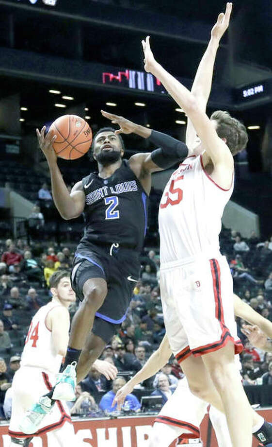 Tramaine Isabell Jr. of Saint Louis University (2) drives past Davidson's Luka Brajkovic (35) in Saturday's Atlantic 10 Tournament semifinal game in New York. SLU won 67-44. Photo: AP Photo