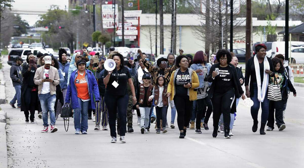 Women begin to march south along Emancipation Avenue after the speakers event during the March for Black Women Houston 2019, starting at Emancipation Park Saturday, Mar. 16, 2019 in Houston, TX.