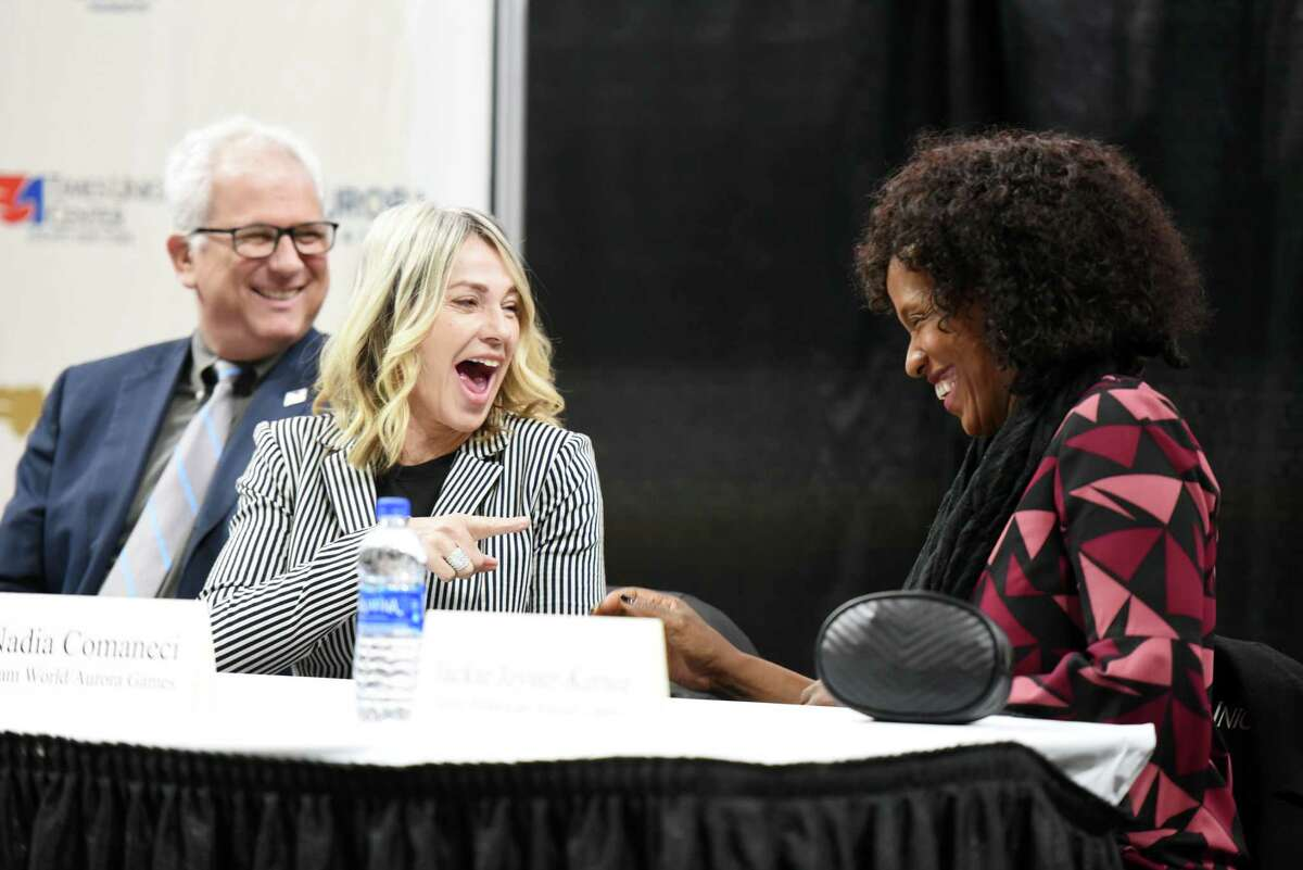 From left Aurora Games Founder Jerry Solomon, former Olympians Nadia Comaneci and Jackie Joyner-Kersee laugh during a press conference for the Aurora Games on Wednesday, Jan. 23, 2019 at the Times Union Center in Albany, N.Y. (Phoebe Sheehan/Times Union)