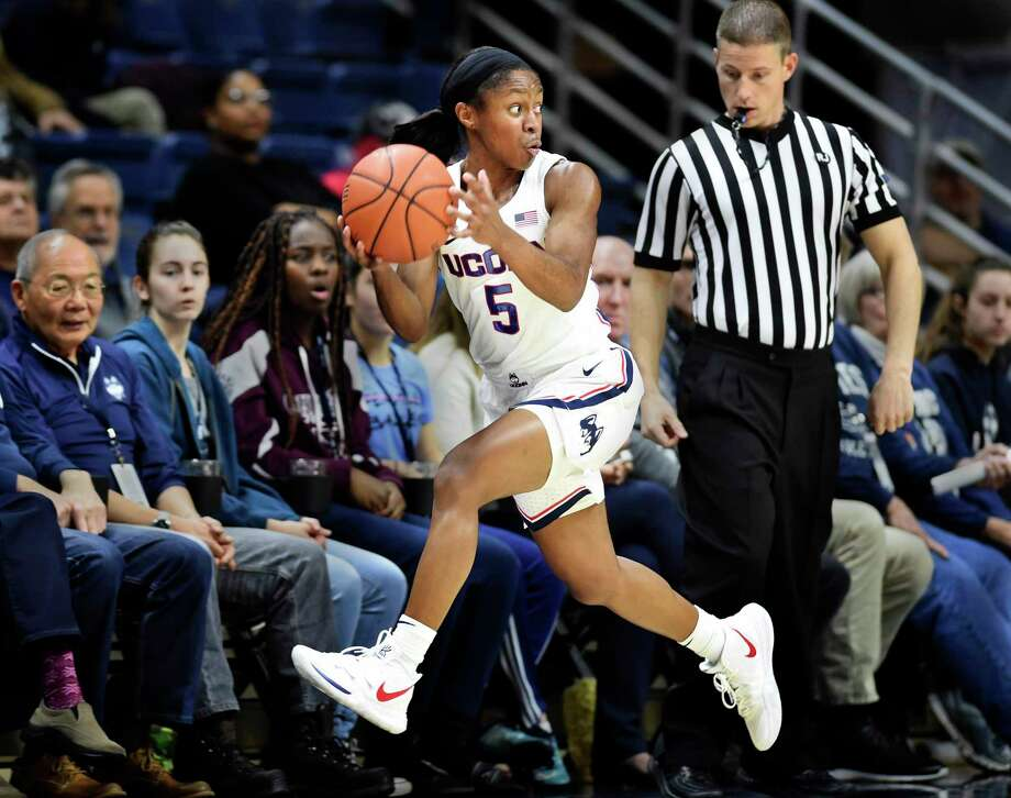 UConn's Crystal Dangerfield (5) keeps the ball inbounds during against Cincinnati on Jan. 9 in Storrs. Dangerfield is averaging 13.7 points and a team-best 6.1 assists per game for the Huskies. Photo: Stephen Dunn / Associated Press / Copyright 2018 The Associated Press. All rights reserved