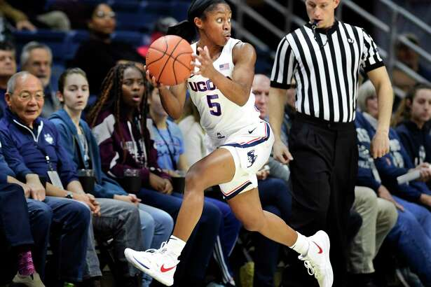 UConn's Crystal Dangerfield (5) keeps the ball inbounds during against Cincinnati on Jan. 9 in Storrs. Dangerfield is averaging 13.7 points and a team-best 6.1 assists per game for the Huskies.