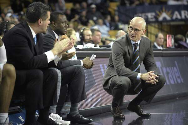UConn coach Dan Hurley, right, watches from the sideline.