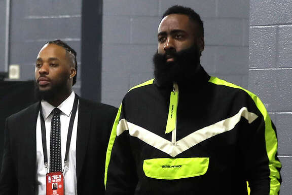 Houston Rockets guard James Harden walks into the Toyota Center with his security guard Vondrae Williams before the start of an NBA game, Friday, March 15, 2019, in Houston.