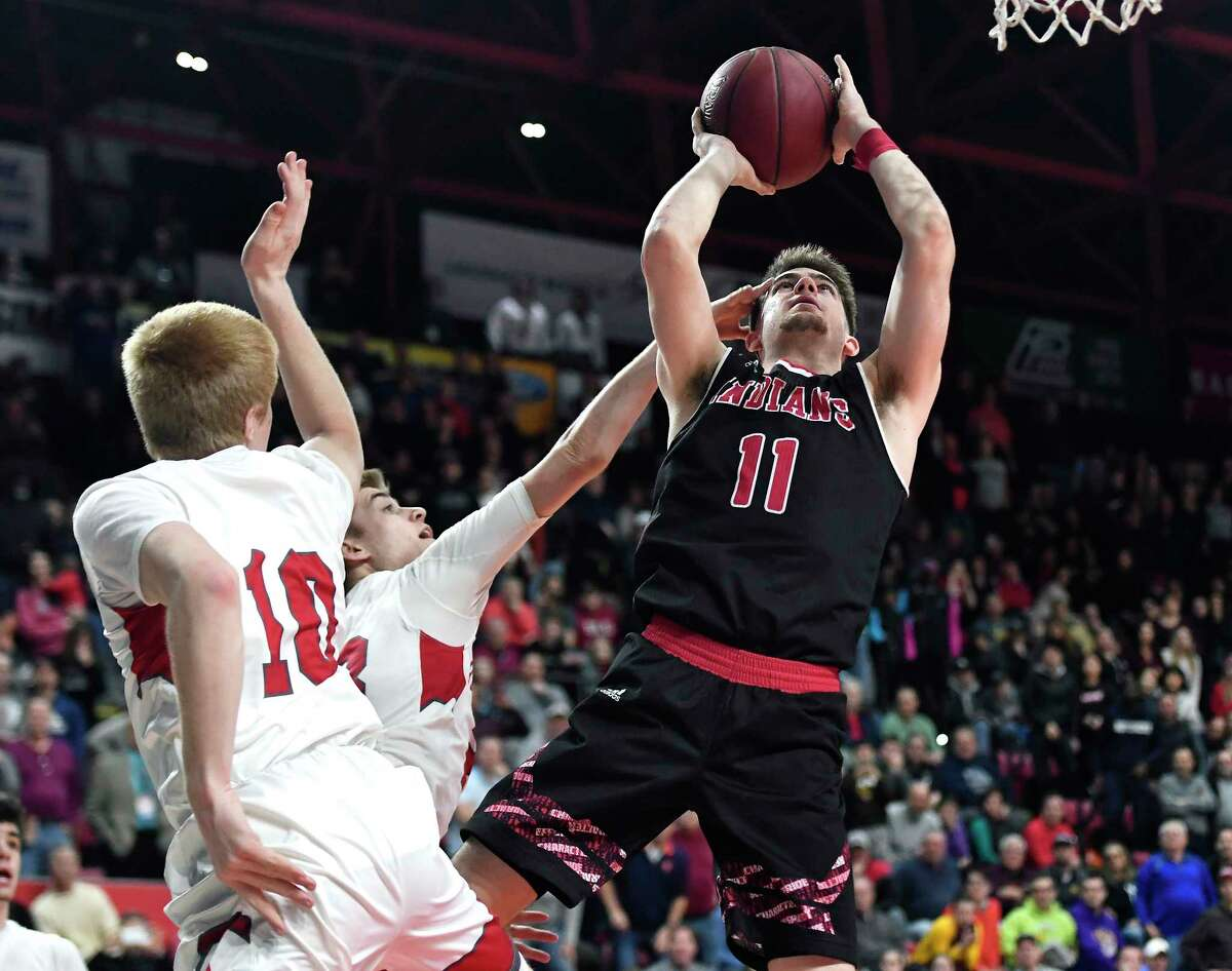 Glens Falls' Joseph Girard III, right, drives for the game-winning basket while defended by Lowville's Aidan MacAulay, center, and Brett Tiffany during the Class B final at the NYSPHSAA Boys Basketball Championships in Binghamton, N.Y., Saturday, March 16, 2019. Glens Falls won the Class B state title with a 75-74 overtime win over Lowville-III. (Adrian Kraus / Special to the Times Union)