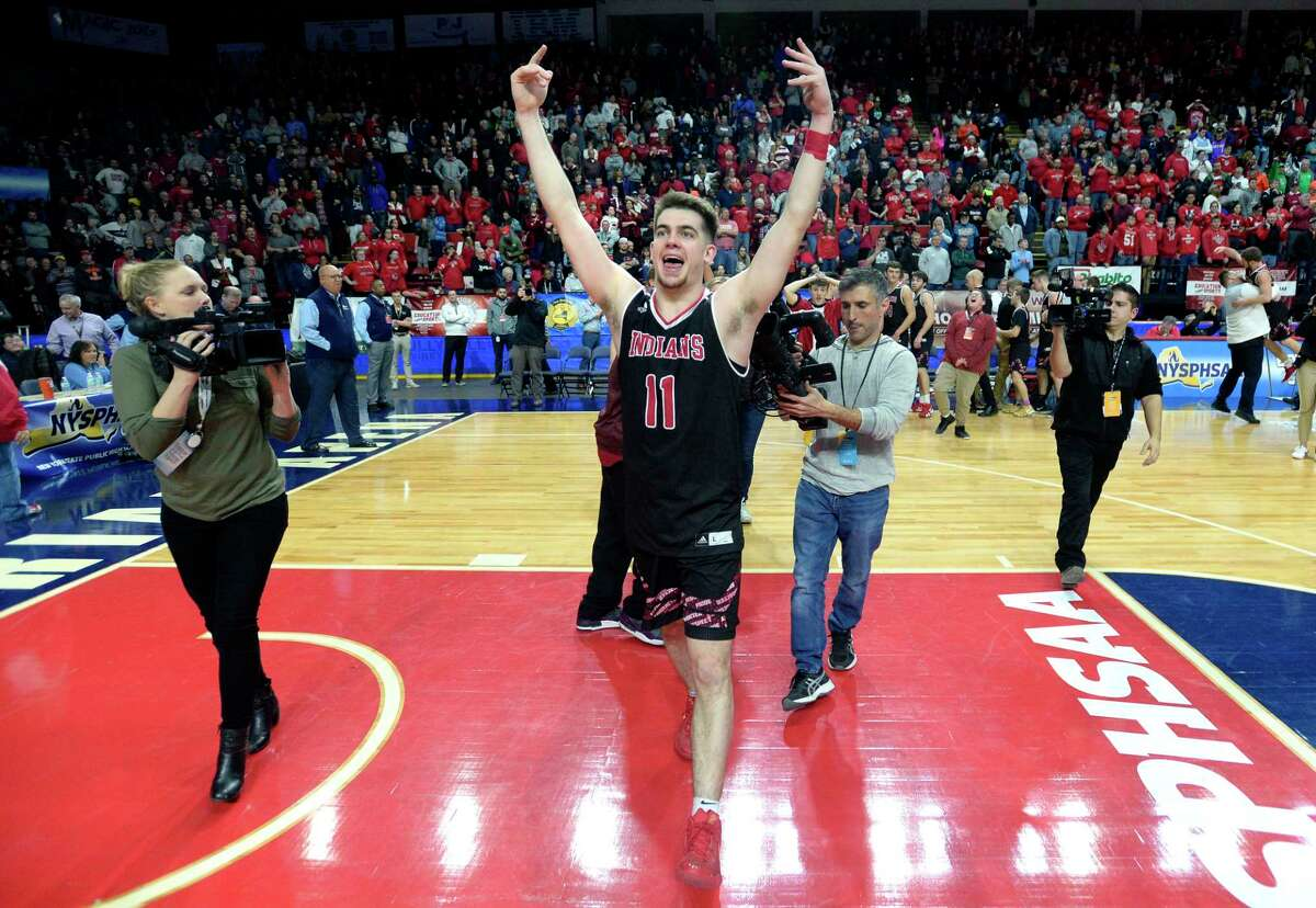 Glens Falls' Joseph Girard III gestures toward the student fan section after winning the Class B final at the NYSPHSAA Boys Basketball Championships in Binghamton, N.Y., Saturday, March 16, 2019. Glens Falls won the Class B state title with a 75-74 overtime win over Lowville-III. (Adrian Kraus / Special to the Times Union)