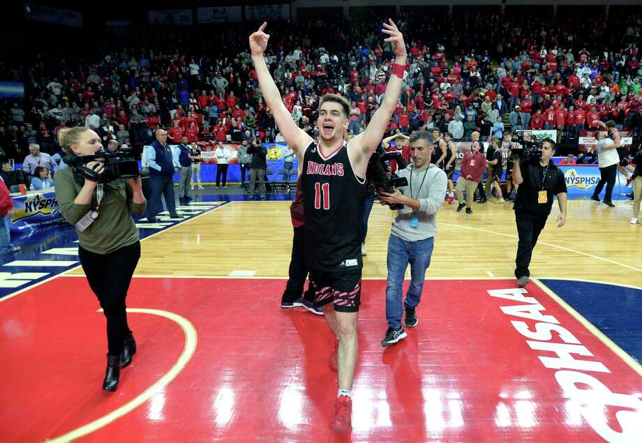 Glens Falls' Joseph Girard III gestures toward the student fan section after winning the Class B final at the NYSPHSAA Boys Basketball Championships in Binghamton, N.Y., Saturday, March 16, 2019. Glens Falls won the Class B state title with a 75-74 overtime win over Lowville-III. (Adrian Kraus / Special to the Times Union) Photo: Adrian Kraus / © akoPhoto 2019