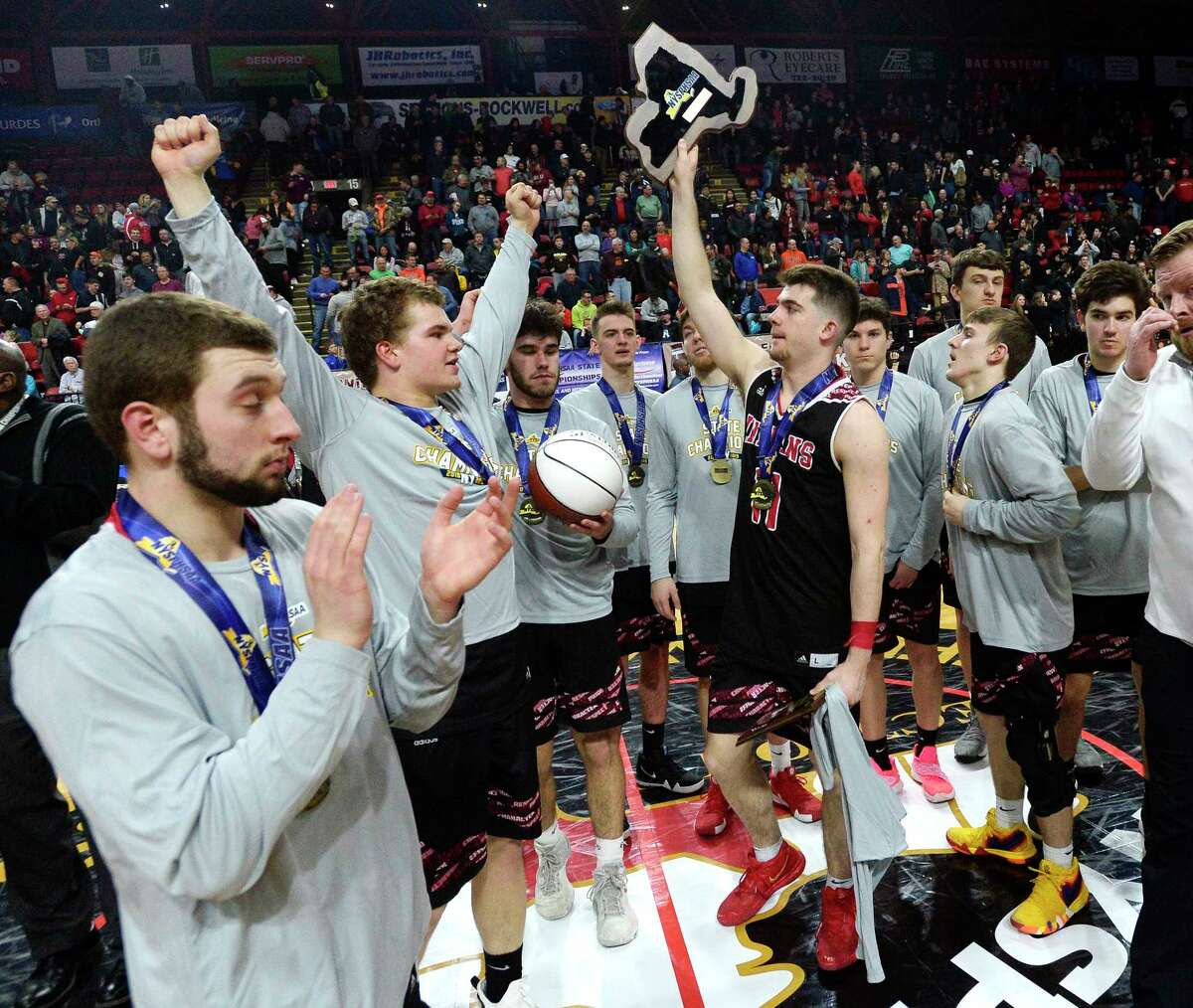 Glens Falls' Joseph Girard III lifts the champ[ionship plaque after the Class B final at the NYSPHSAA Boys Basketball Championships in Binghamton, N.Y., Saturday, March 16, 2019. Glens Falls won the Class B state title with a 75-74 overtime win over Lowville-III. (Adrian Kraus / Special to the Times Union)