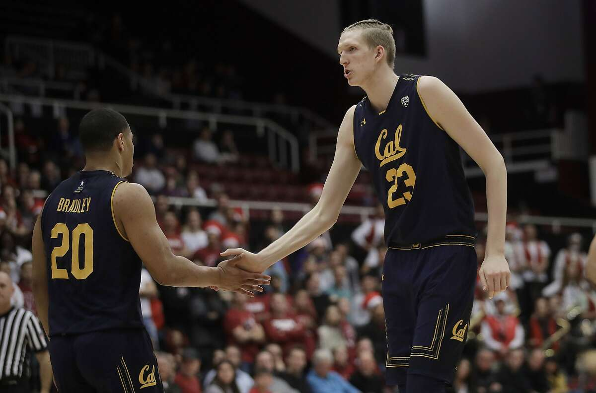California guard Matt Bradley (20) celebrates with center Connor Vanover (23) during the first half of the team's NCAA college basketball game against Stanford in Stanford, Calif., Thursday, March 7, 2019. (AP Photo/Jeff Chiu)
