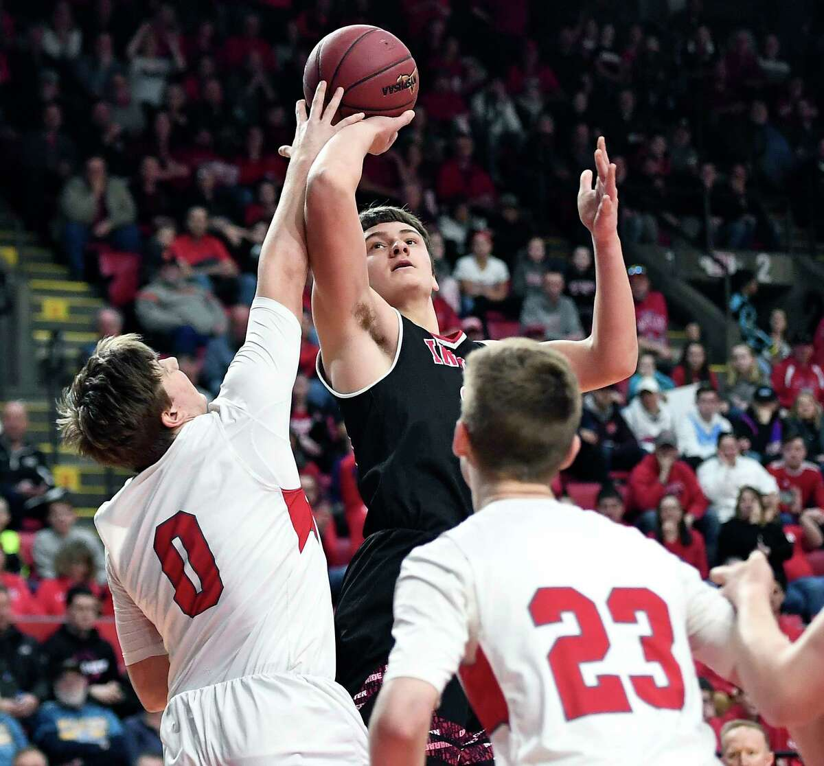 Glens Falls' Nick Danahy, top, is defended by Lowville's Chad Bach during the Class B final at the NYSPHSAA Boys Basketball Championships in Binghamton, N.Y., Saturday, March 16, 2019. Glens Falls won the Class B state title with a 75-74 overtime win over Lowville-III. (Adrian Kraus / Special to the Times Union)