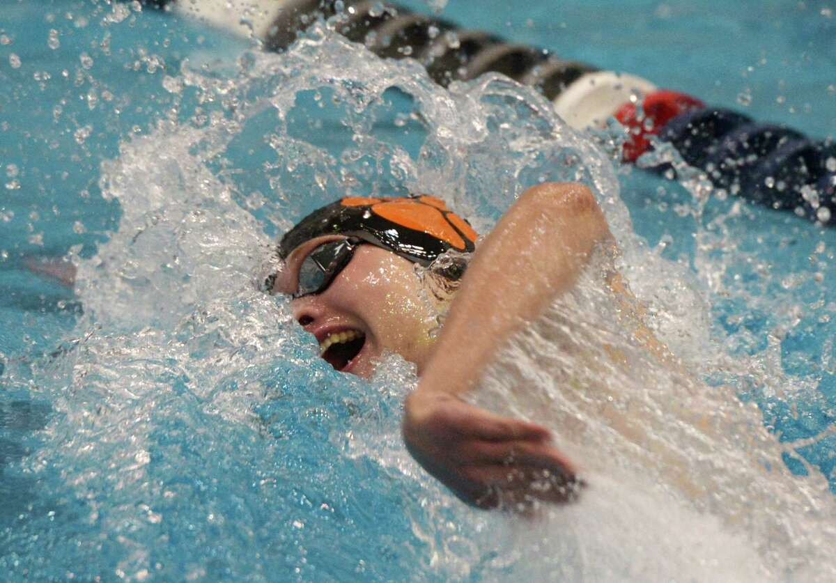 Ridgefield's Connor Hunt swims to a first-place finish in the 200-yard freestyle final during the Class LL championship at Southern Connecticut State University's Hutchinson Natatorium in New Haven on March 11.