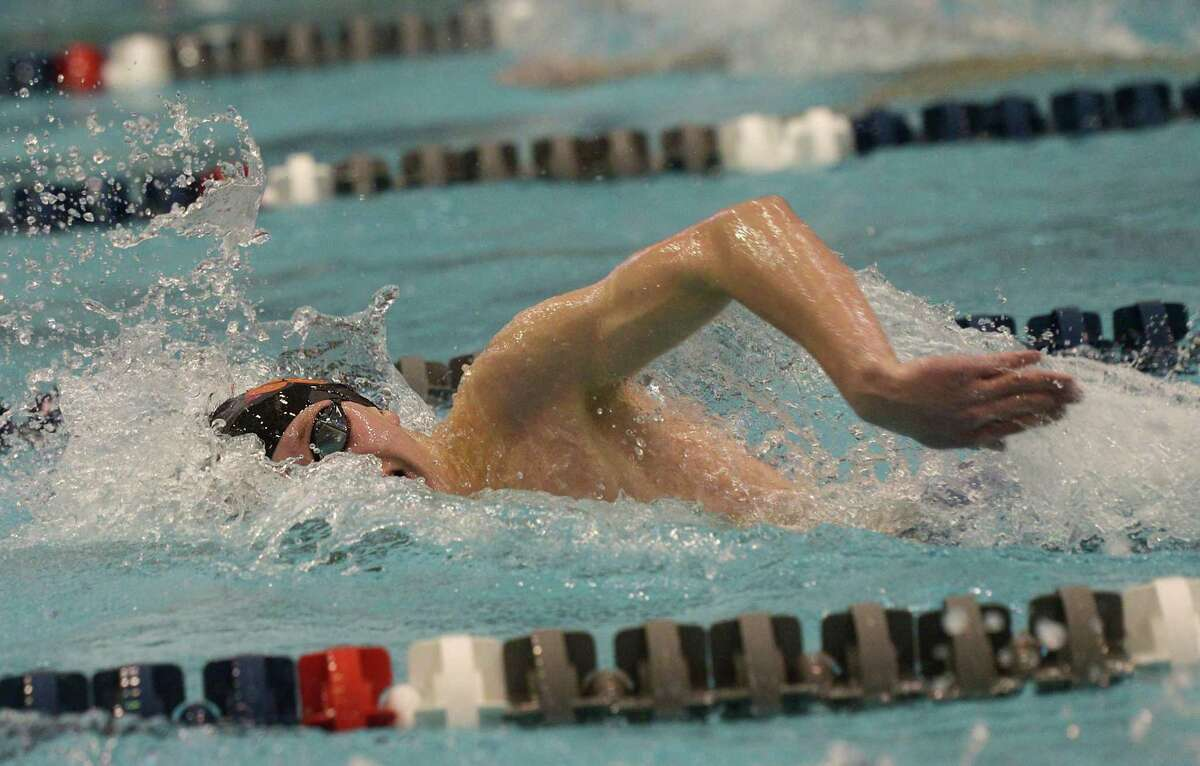 Ridgefield's Connor Hunt swims to a first-place finish in the 500-yard freestyle final during the Class LL championships at Southern Connecticut State University's Hutchinson Natatorium in New Haven on March 11.