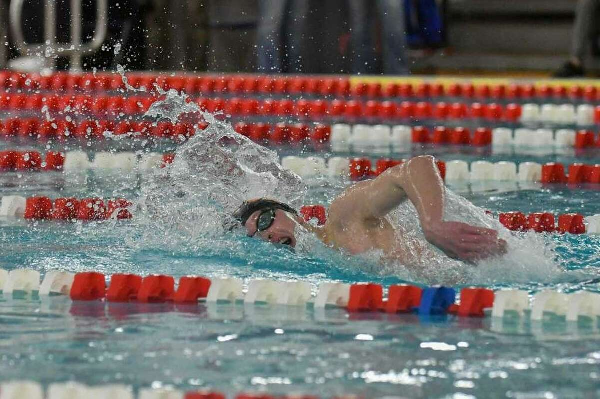 Ridgefield sophomore Connor Hunt swims to first-place in the 500-yard freestyle at the FCIAC championship meet.
