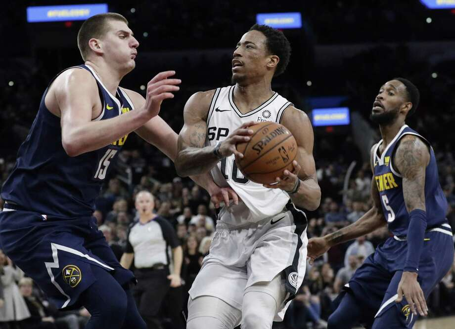 San Antonio Spurs guard DeMar DeRozan (10) drives to the basket against Denver Nuggets center Nikola Jokic (15) during the second half of an NBA basketball game, in San Antonio, Monday, March 4, 2019. (AP Photo/Eric Gay) Photo: Eric Gay, STF / Associated Press / Copyright 2019 The Associated Press. All rights reserved.