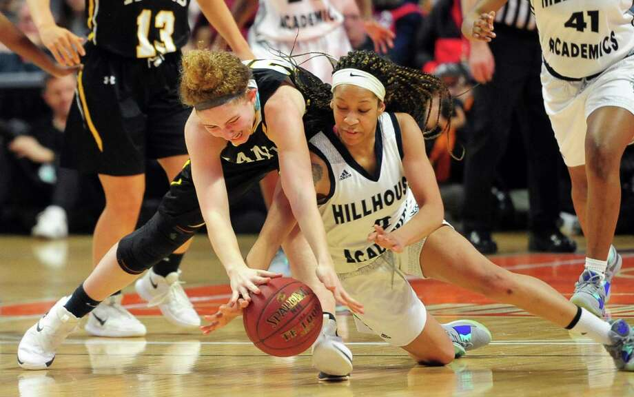 Daniel Hand's Summer Adamds (20), left, and Hillhouse's Ciara Little (2) reach for a loose ball during Class L girls basketball championship action in Uncasville, Conn., on Saturday Mar. 16, 2019. Photo: Christian Abraham / Hearst Connecticut Media / Connecticut Post